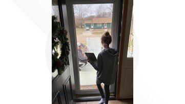 PHOTO: Teacher comes to student's house to help with math problem through door