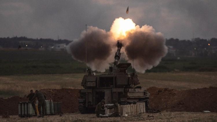 Rocket from Gaza kills 2 as Israel topples 6-story building