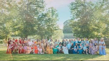 After infertility battle, photographer gathers 79 mothers and 'rainbow babies' for a breathtaking photoshoot
