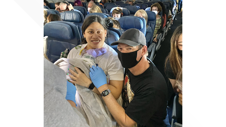 Flight to Hawaii lands with extra passenger on board, thanks to a doctor and 3 nurses