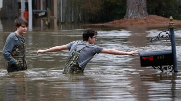Door-to-door evacuations continue in Mississippi as Pearl River crests