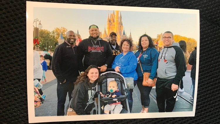 Isaiah Tuckett (far right) among the seven members of his family he took to Disney World.