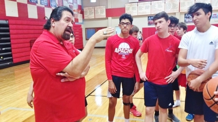 BKB Antonian coach Rudy Bernal talks to his players after an offseason workout
