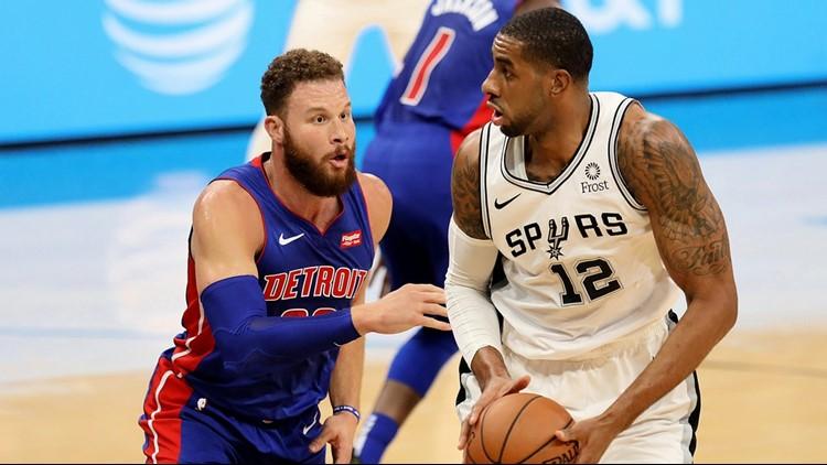 Spurs forward LaMarcus Aldridge goes against Pistons forward Blake Griffin