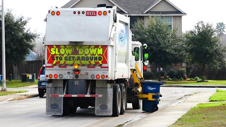 Slow down around trash trucks—it's the law