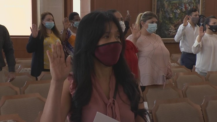20 immigrants, each representing a different nation, take oath of citizenship in San Antonio
