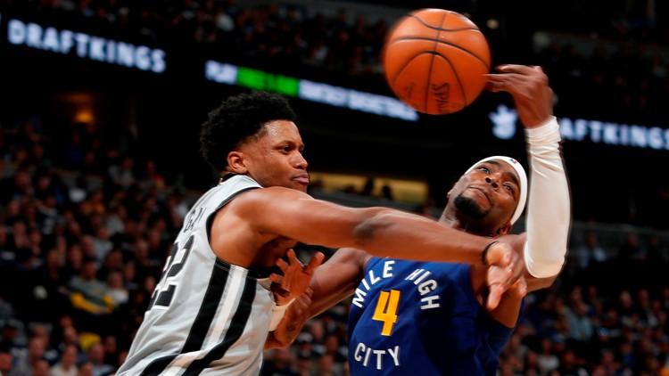 BKN Spurs forward Rudy Gay battles Nuggets forward Paul Millsap for a loose ball in Game 1