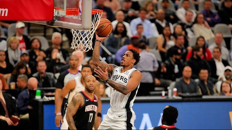 BKN Spurs forward DeMar DeRozan goes up for a shot against the Rockets 12032019