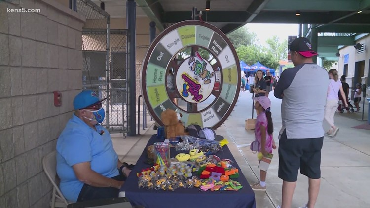 HOMERUN! Everybody's a winner with the prize wheel at Wolff Stadium, and the joyful worker who runs it
