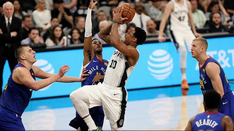 BKN Spurs guard DeMar DeRozan goes up for a shot against the Nuggets iin Game 4