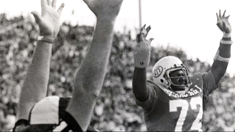 FBC Texas A&I offensive tackle Larry McFarland signals TD in 1975 title game