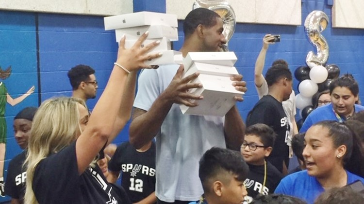 BKN Spurs forward LaMarcus Aldridge gets ready to give away iPads at this back-to-school party