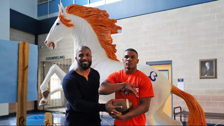 FBH Brandeis RB Corion Holmes with his father Priest Holmes 11272019