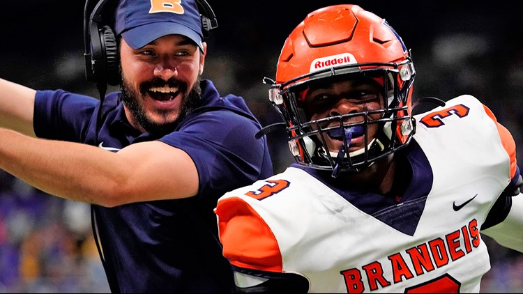 FBH Brandeis RB Corion Holmes celebrating with assistant coach Aaron Grubb 11222019