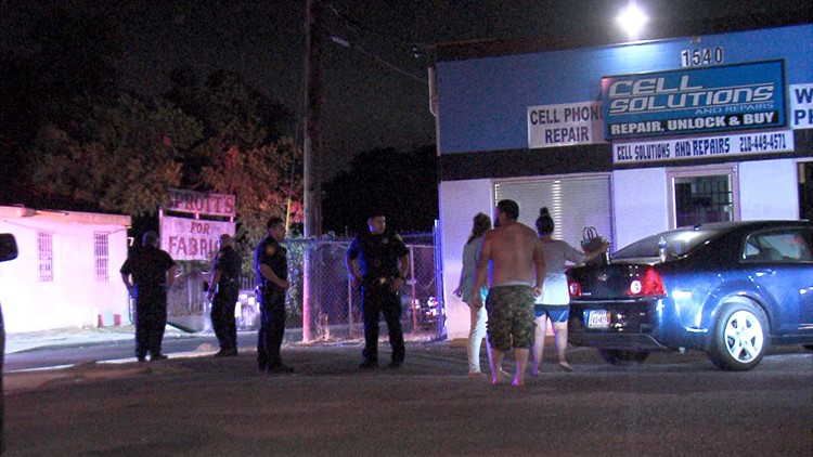 Police say a man was outside the cell phone store when two men and a woman down the street fired a shot at him.