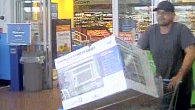 Surveillance photos show the man walking out of the Walmart with an air conditioner in his cart.