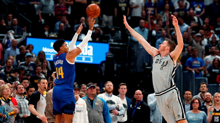 BKN Nuggets guard Gary Harris shoots over Spurs center Jakob Poeltl in Game 5