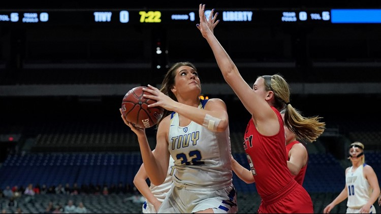 Kerrville Tivy senior center Catherine Center looks for a shot against Liberty Frisco
