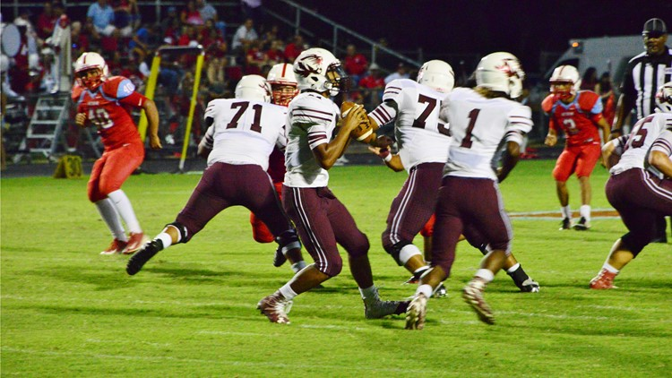 FBH Floresville quarterback Darian Mayberry gets ready to pass against Antonian in 2016_1535237877378.jpg.jpg