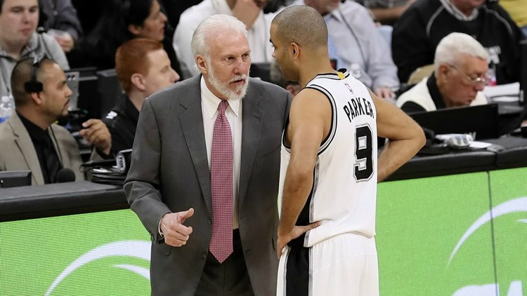 Spurs point guard Tony Parker talking with coach Gregg Popovich