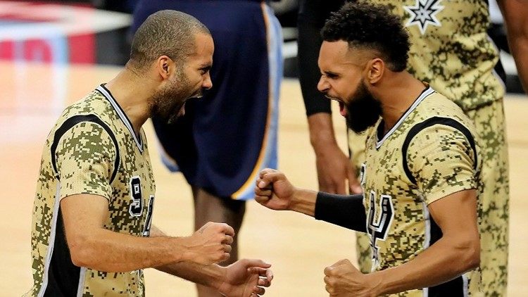 Spurs guards Tony Parker, left, and Patty Mills celebrate a big play