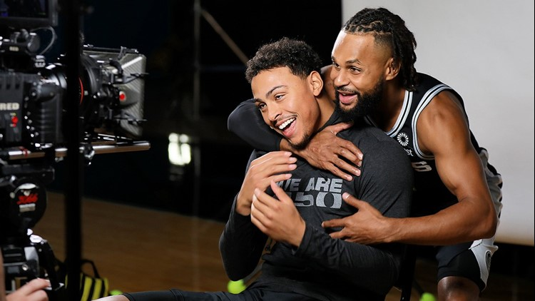 BKN Spurs guards Patty Mills and Bryn Forbes engage in some horseplay at 2018 media day 0924_1538914106041.jpg.jpg