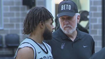 Coach Pop rocks 'BETO' cap during Spurs practice on Friday