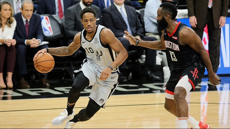 BKN Spurs guard DeMar DeRozan goes against Rockets guard James Harden 2018_1543647888697.jpg.jpg