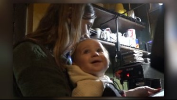 Mom straps on baby to wait tables during NC snow storm
