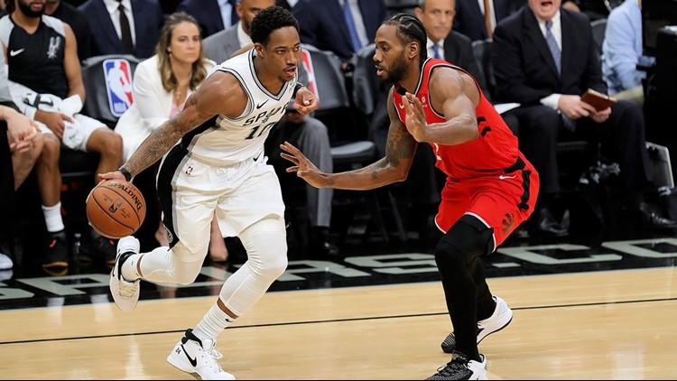BKN Spurs guard DeMar DeRozan goes against Toronto forward Kawhi Leonard 01032018_1546569635203.jpg.jpg