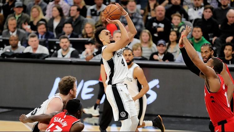 BKN Spurs guard Derrick White shoots against the Raptors_1546697356450.jpg.jpg