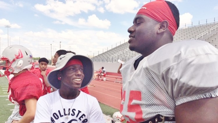 FBH Judson junior Bryce Wisdom talks with offensive tackle Kamron Scott at practice