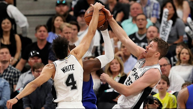 Spurs point guard Derrick White and center Jakob Poeltl block a shot in Game 4 against the Nuggets