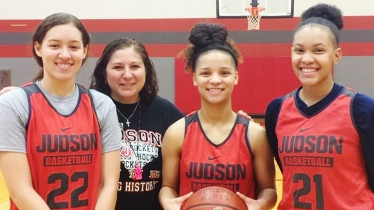 Judson coach Triva Corrales with Kyra White and Corina Carter and Tiffany McGarity
