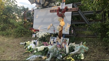 Family, friends place cross for Andreen McDonald near spot where she was found