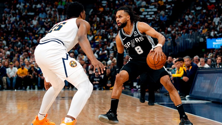 Spurs guard Patty Mills goes against Nuggets guard Malik Beasley in Game 2