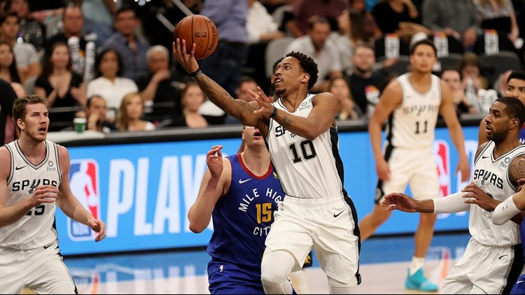 BKN Spurs guard DeMar DeRozan goes up for a shot against the Nuggets in Game 3