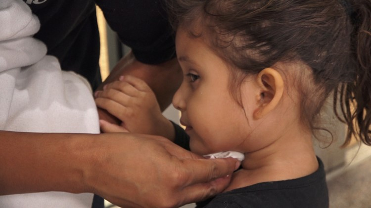 Four-year-old Honduran, Kimberlin Arqueta, gets treatment for ear infection while at migrant shelter