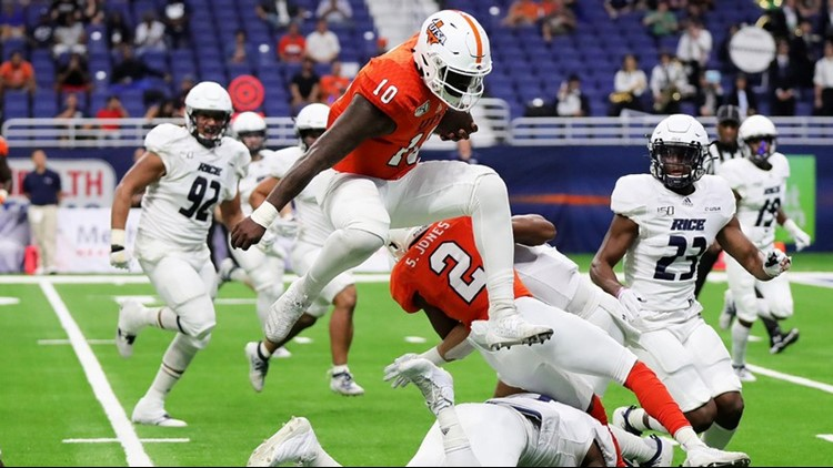 FBC UTSA quarterback Lowell Narcisse hurdles a Rice defender in 2019