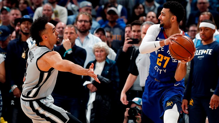 BKN Spurs point guard Derrick White plays defense against Nuggets guard Jamal Murray in Game 5