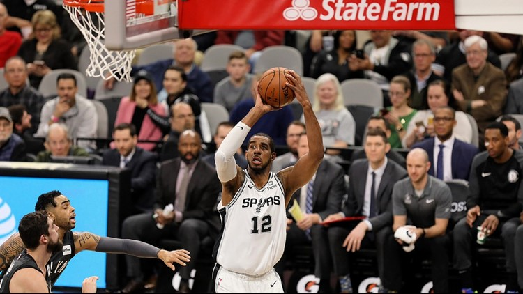 Spurs forward LaMarcus Aldridge goes up for a shot against the Nets