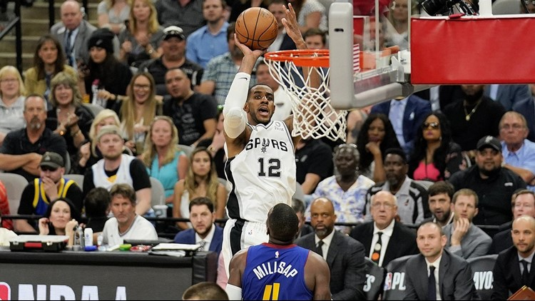 BKN Spurs forward LaMarcus Aldridge shoots against the Nuggets in Game 6
