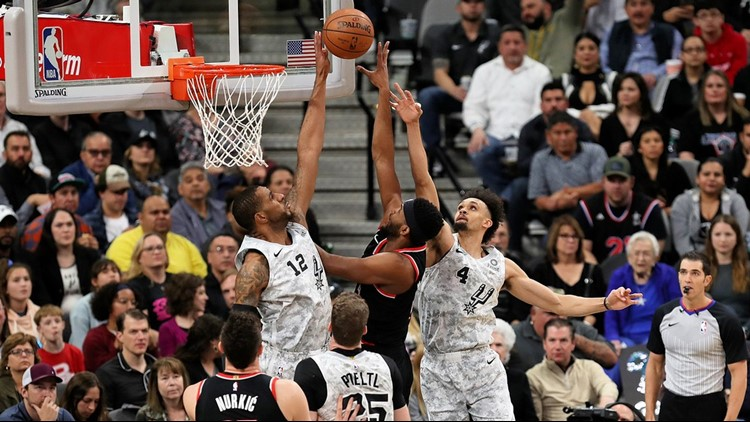 BKN Spurs forward LaMarcus Aldridge contests a shot by Blazers forward Maurice Harkless