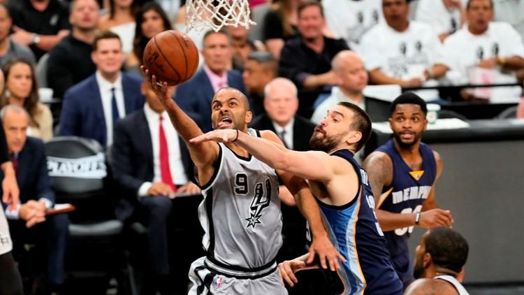 Spurs point guard Tony Parker drives past Grizzlies center Marc Gasol