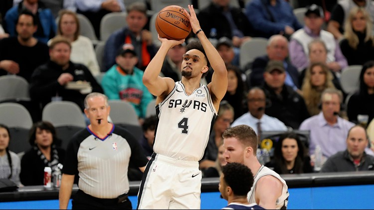 BKN Spurs guard Derrick White shoots against the Nuggets in Game 3
