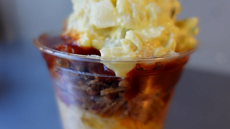 BBQ parfait loaded with mac, beans, pulled pork and potato salad | Texas food truck getting a lot of buzz