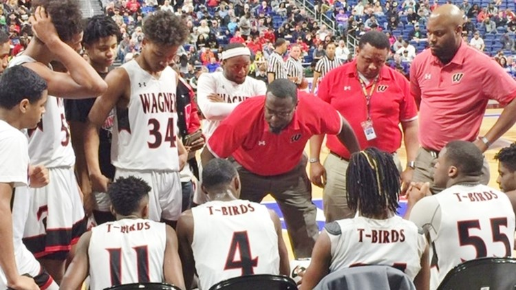 Wagner coach Rodney Clark talks to his players during a timeout in the fourth quarter