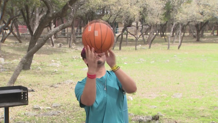 Miguel spins basketball