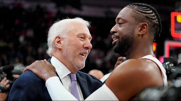Spurs coach Gregg Popovich and Miami Heat guard Dwyane Wade 03202019