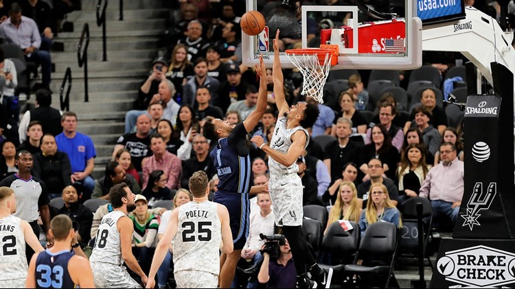 BKN Derrick White blocks a shot by former Spur Kyle Anderson